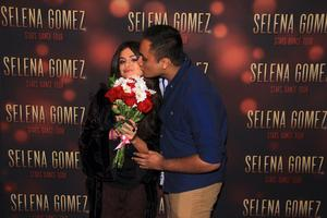 Selena Gomez, kissed by a lucky guy during Meet and Greet in Minneapolis, Minnesota