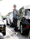 *Adds* Charlize Theron - Candids in Hollywood - Mar 12, 2011 (x13 +3)